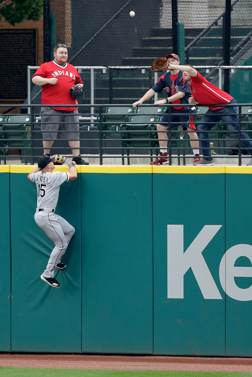. Chicago White Sox\'s Adam Engel jumps on the wall but can\'t reach a three-run home run hit by Cleveland Indians\' Jose Ramirez in the first inning of a baseball game, Wednesday, June 20, 2018, in Cleveland. Francisco Lindor and Michael Brantley scored on the play. (AP Photo/Tony Dejak)