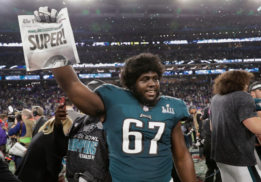 . Philadelphia Eagles offensive guard Chance Warmack (67) holds up a newspaper after winning the NFL Super Bowl 52 football game against the New England Patriots, Sunday, Feb. 4, 2018, in Minneapolis. The Eagles won 41-33. (AP Photo/Tony Gutierrez)