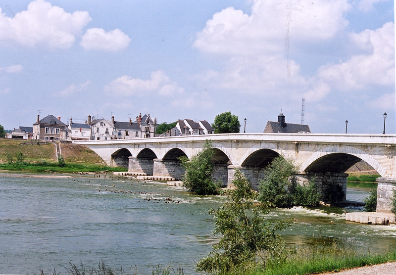 White bridge crosses a river in France.