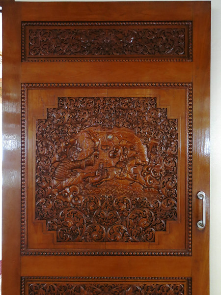 A teak door in the Burmese Buddhist Temple