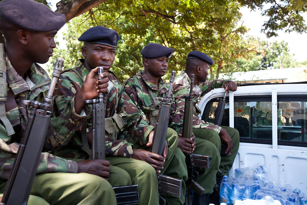 . General Service Unit (GSU) soldiers sit at the back on a pick up at the Tononoka grounds in Mombasa to ensure safety following the results of the general elections on March 9, 2013.  AFP PHOTO / IVAN  Lieman/AFP/Getty Images