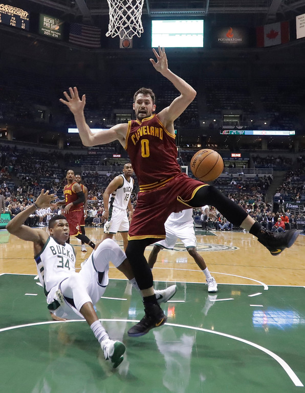 . Milwaukee Bucks\' Giannis Antetokounmpo fouls Cleveland Cavaliers\' Kevin Love during the first half of an NBA basketball game Tuesday, Nov. 29, 2016, in Milwaukee. (AP Photo/Morry Gash)