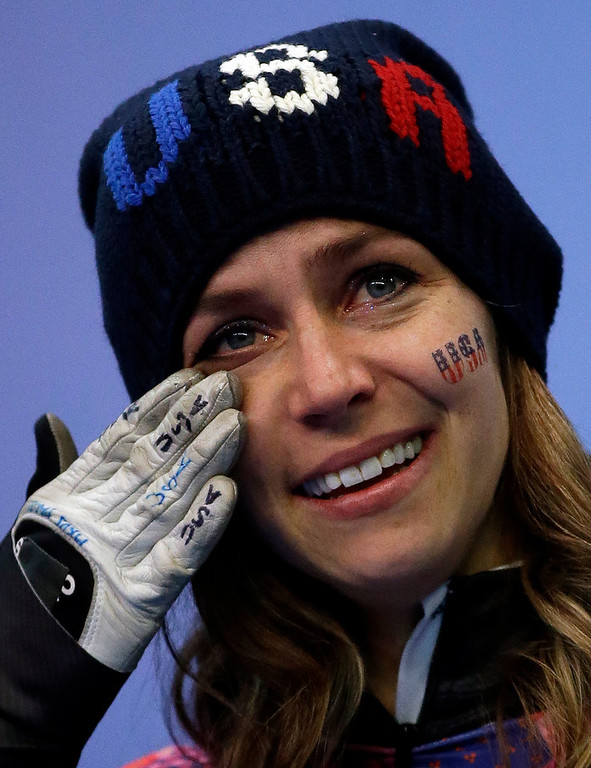 . Noelle Pikus-Pace of the United States cries during the flower ceremony after winning the silver medal during the women\'s skeleton competition at the 2014 Winter Olympics, Friday, Feb. 14, 2014, in Krasnaya Polyana, Russia. (AP Photo/Dita Alangkara)