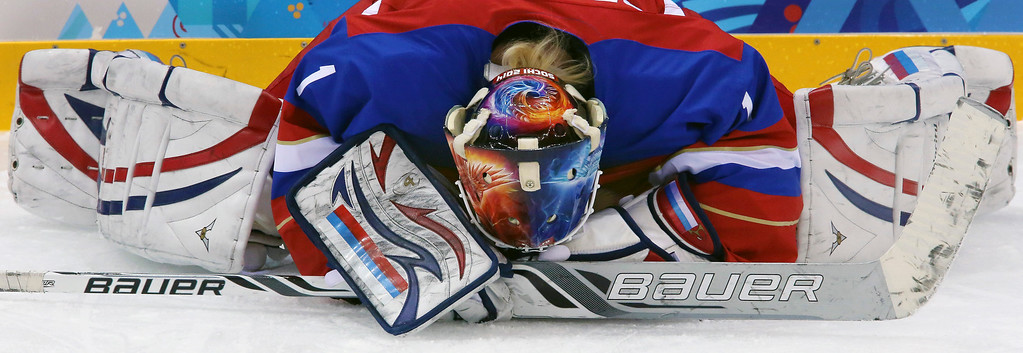 . Goalkeeper Anna Prugova of Russia stretches before the game with Sweden at the 2014 Winter Olympics women\'s ice hockey tournament at Shayba Arena, Thursday, Feb. 13, 2014, in Sochi, Russia. (AP Photo/J. David Ake)