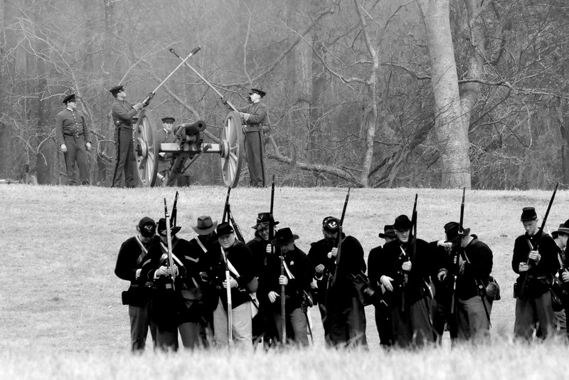 """Citadel reenactors mark an """"X"""" with the worm and sponge to signify a misfire from a canon. The Skirmish at Gamble's Hotel happened on March 5, 1885 when 500 federal soldiers, under the command of Reuben Williams of the 12th Indiana Infantry, marched into Florence to destroy the railroad depot but were met by Confederate soldiers backed up with 400 militia. The reenactment, held by the 23rd South Carolina Infantry, was held at the Rankin Plantation in Florence, South Carolina on Saturday, March 5, 2011. Photo Copyright 2011 Jason Barnette"""