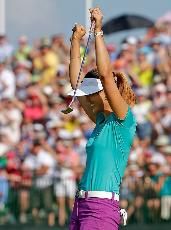 . Michelle Wie reacts after winning the U.S. Women\'s Open golf tournament in Pinehurst, N.C., Sunday, June 22, 2014. (AP Photo/Chuck Burton)