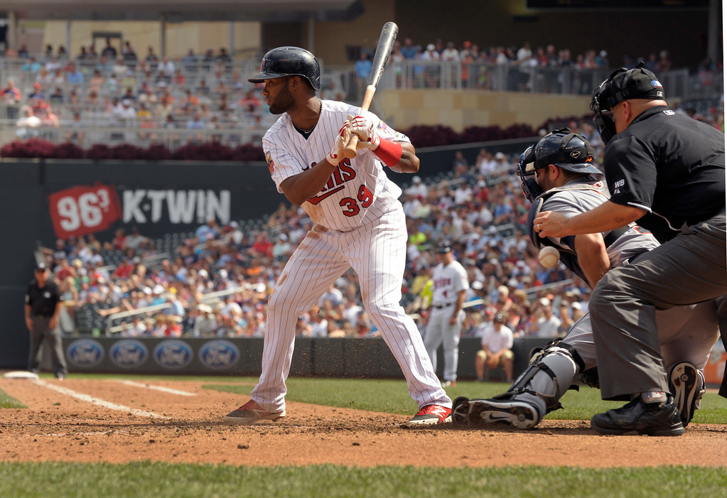 . Minnesota Twins\' Danny Santana bats against the Detroit Tigers� during  a baseball game in Minneapolis, Sunday, Aug. 24, 2014. (AP Photo/Tom Olmscheid)