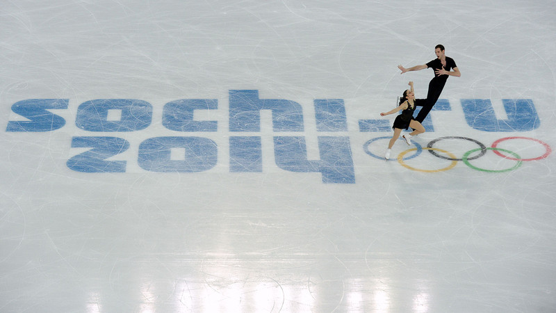. US Simon Shnapir and US Marissa Castelli perform during the Figure Skating Pairs Team Short Program at the Iceberg Skating Palace during the Sochi Winter Olympics on February 6, 2014. (YURI KADOBNOV/AFP/Getty Images)