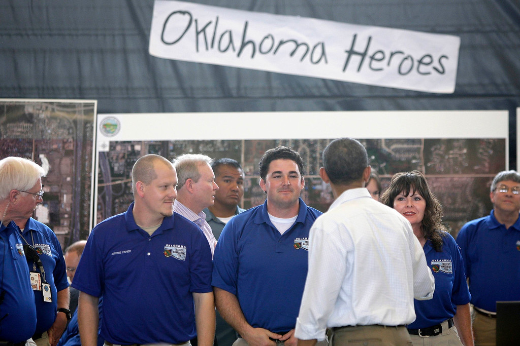 . U.S. President Barack Obama greets emergency workers at Fire Station #1 in Moore, Oklahoma, May 26, 2013. Obama arrived in Moore on Sunday to tour the town that was hammered last week by a powerful tornado that killed 24 people and assure its residents that the federal government would provide long-term help.  REUTERS/Jonathan Ernst