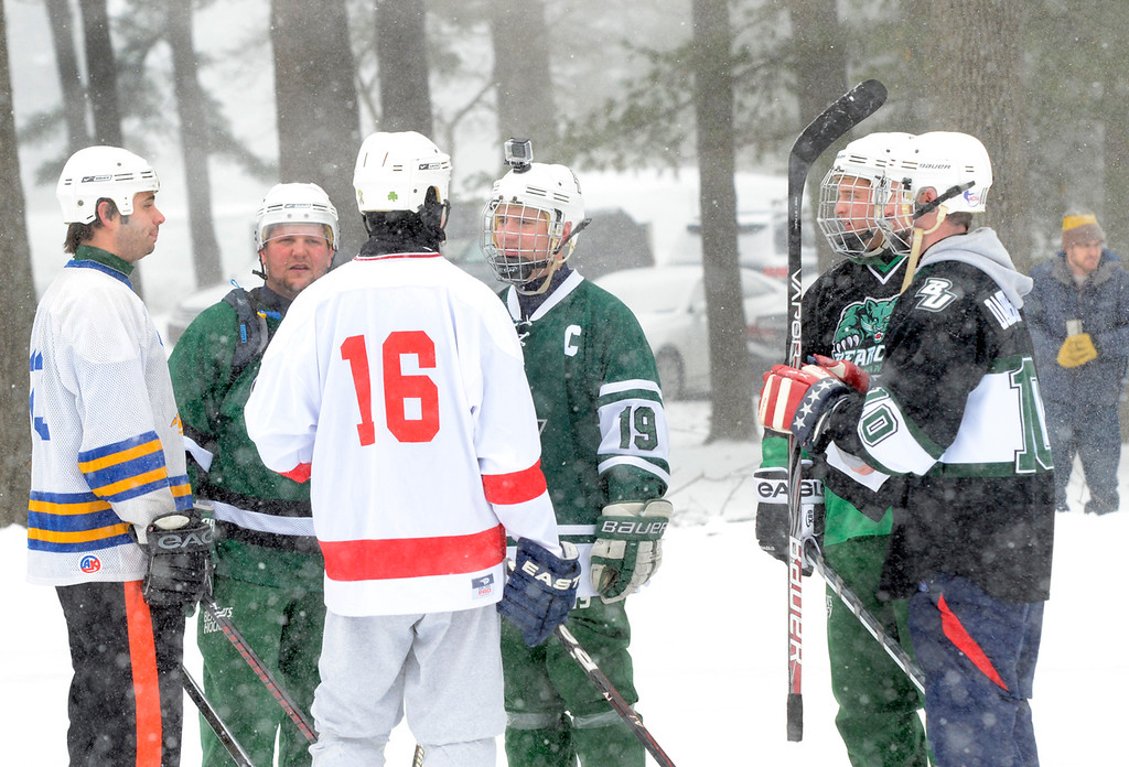 . Ed Burke - The Saratogian 01/25/14 Playing for team Beercat University, Joe Livsey of Buffalo wears a video camera on his helmet Saturday during the Saratoga Frozen Springs Classic Hockey Tournament at Saratoga Spa State Park.