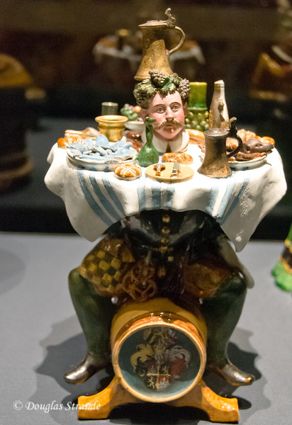 The glutton's punishment: surrounded by food he cannot reach.   Art History Museum, Vienna