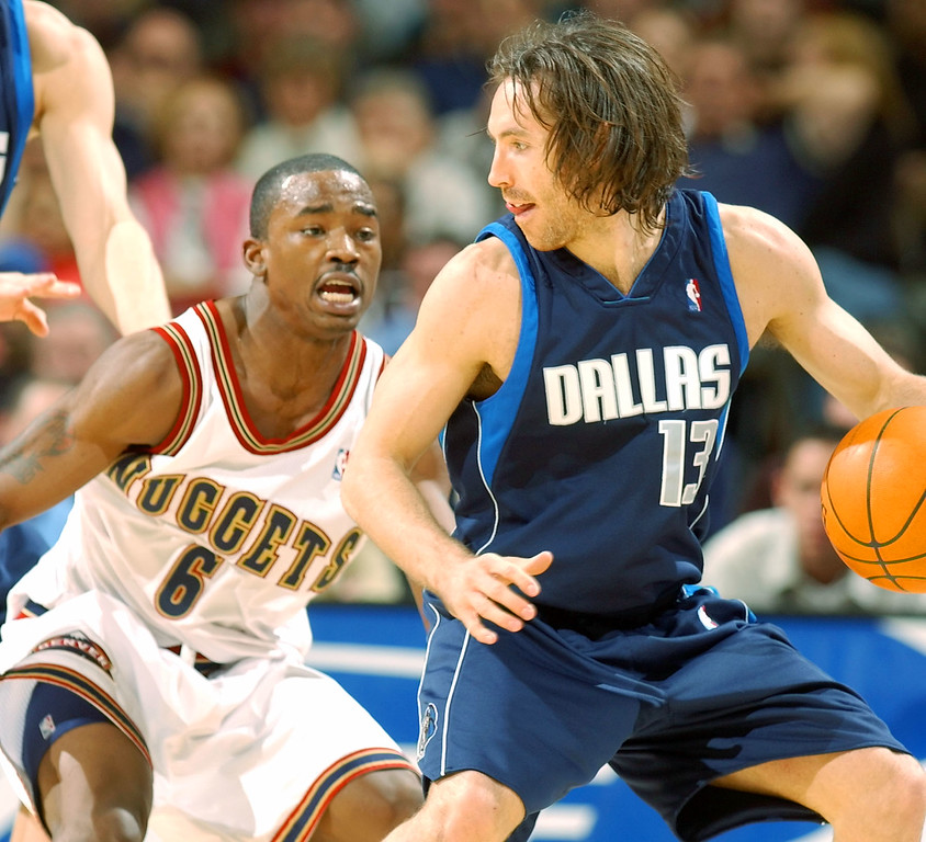 . Dallas Mavericks guard Steve Nash, right, works the ball inside against Denver Nuggets guard Junior Harrington in the fourth quarter of the Mavericks\' 80-75 victory in Denver on Wednesday, Dec. 18, 2002. Nash scored 18 points in the win. (AP Photo/David Zalubowski)