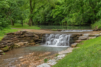 Stream through canyon park with cascading water