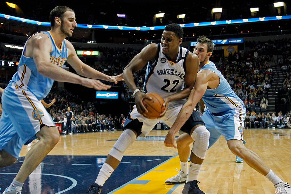 . Denver Nuggets center Kosta Koufos, left, and forward Danilo Gallinari, right, of Italy, pressure Memphis Grizzlies forward Rudy Gay (22) in the second half of an NBA basketball game on Saturday, Dec. 29, 2012, in Memphis, Tenn. The Grizzlies won 81-72. (AP Photo/Lance Murphey)
