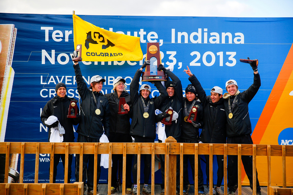 . TERRE HAUTE, IN - NOVEMBER 23: The University of Colorado men\'s cross country team celebrates its NCAA cross country national championship win at Lavern Gibson Championship Cross Country Course on Saturday, November 23, 2013, in Terre Haute, Indiana. It\'s the team\'s fourth title in school history. (Photo by Aaron P. Bernstein/Special to The Denver Post)