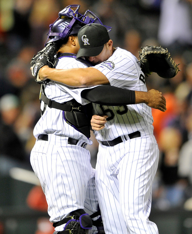 . Colorado Rockies catcher Wilin Rosario, left, and closing pitcher Rafael Betancourt celebrate a 6-3 victory over the  San Diego Padres after a baseball game on Saturday, April 6, 2013, in Denver. (AP Photo/Jack Dempsey)
