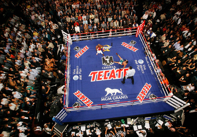 . Referee Tony Weeks watches Floyd Mayweather Jr., upper left, knock down Juan Manuel Marquez, of Mexico, during their non-title welterweight boxing match in Las Vegas, Saturday, Sept. 19, 2009. Mayweather won by a unanimous decision. (AP Photo/Isaac Brekken)