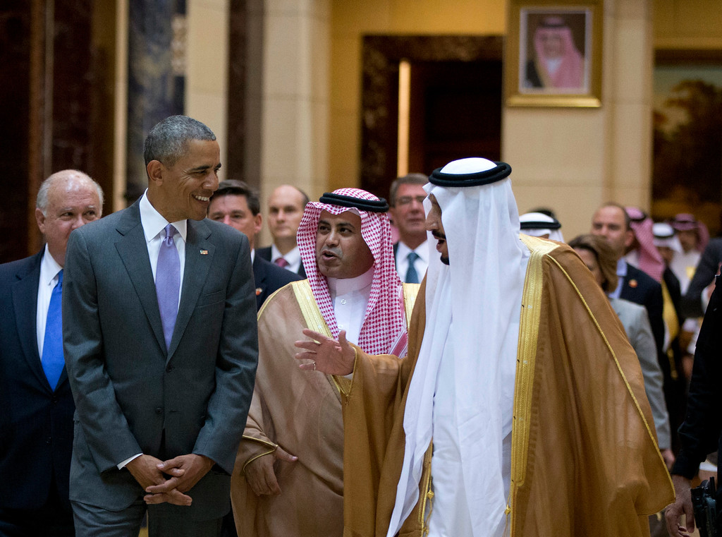 . President Barack Obama and Saudi Arabia\'s King Salman walk to President Obama\'s motorcade after meeting at Erga Palace in Riyadh, Saudi Arabia, Wednesday, April 20, 2016. The president began a six day trip to strategize with his counterparts in Saudi Arabia, England and Germany on a broad range of issues with efforts to rein in the Islamic State group being the common denominator in all three stops. (AP Photo/Carolyn Kaster)