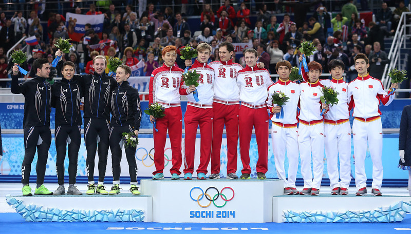 . (L to R) Silver medalist the United States, gold medalists Russia and bronze medalist China celebrate on the podium during the flower ceremony for the Men\'s 5000m Relay on day fourteen of the 2014 Sochi Winter Olympics at Iceberg Skating Palace on February 21, 2014 in Sochi, Russia.  (Photo by Matthew Stockman/Getty Images)