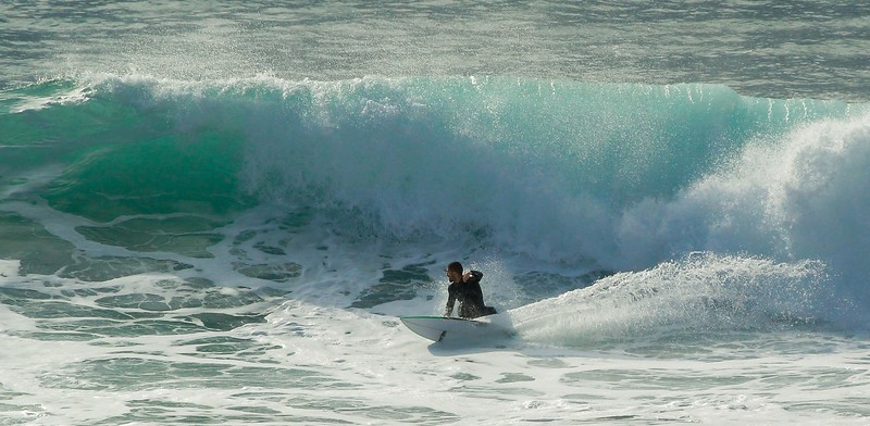 Escaping the break, this surfer re-commits to the wave face as he trades speed for direction.