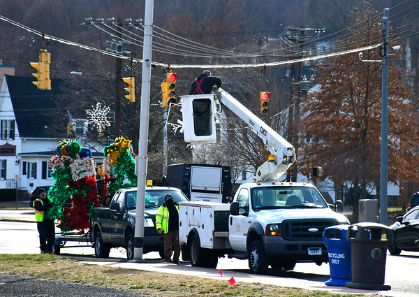 1/2/2019 Mike Orazzi | Staff Bristol Park & Recreation employees Tim Rollins, Doug Trillo and Todd Anderson remove Christmas decorations from North Main Street in Bristol Wednesday afternoon.