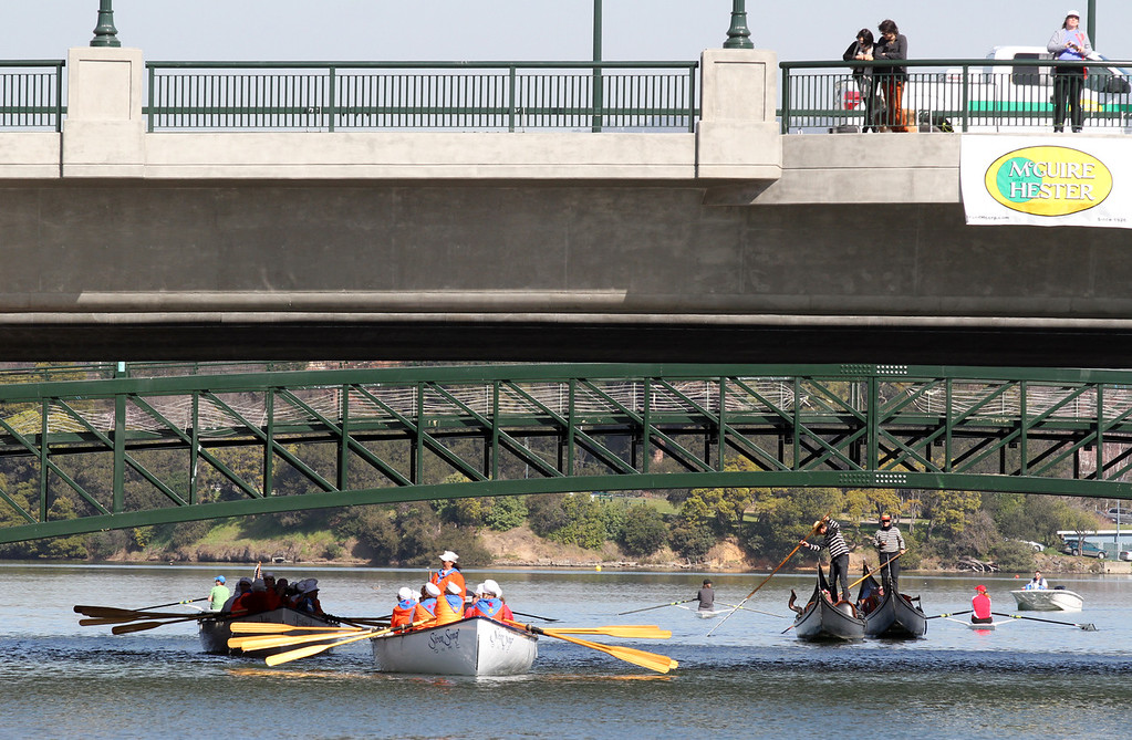 . After Mayor Jean Quan blew the horn, a myriad of boats came under the 12th Street bridge from Lake Merritt along the channel as part of the celebration of the re-opening of a 750-foot section of the Lake Merritt Channel in Oakland, Calif., on Friday, Feb. 22, 2013. The new 100-foot-wide free flowing tidal channel, for the first time since 1869, allows boats to travel from the Lake Merritt Channel to Lake Merritt . This is the first of a series of projects that will eventually connect Lake Merritt to the Oakland Estuary. (Laura A. Oda/Staff)
