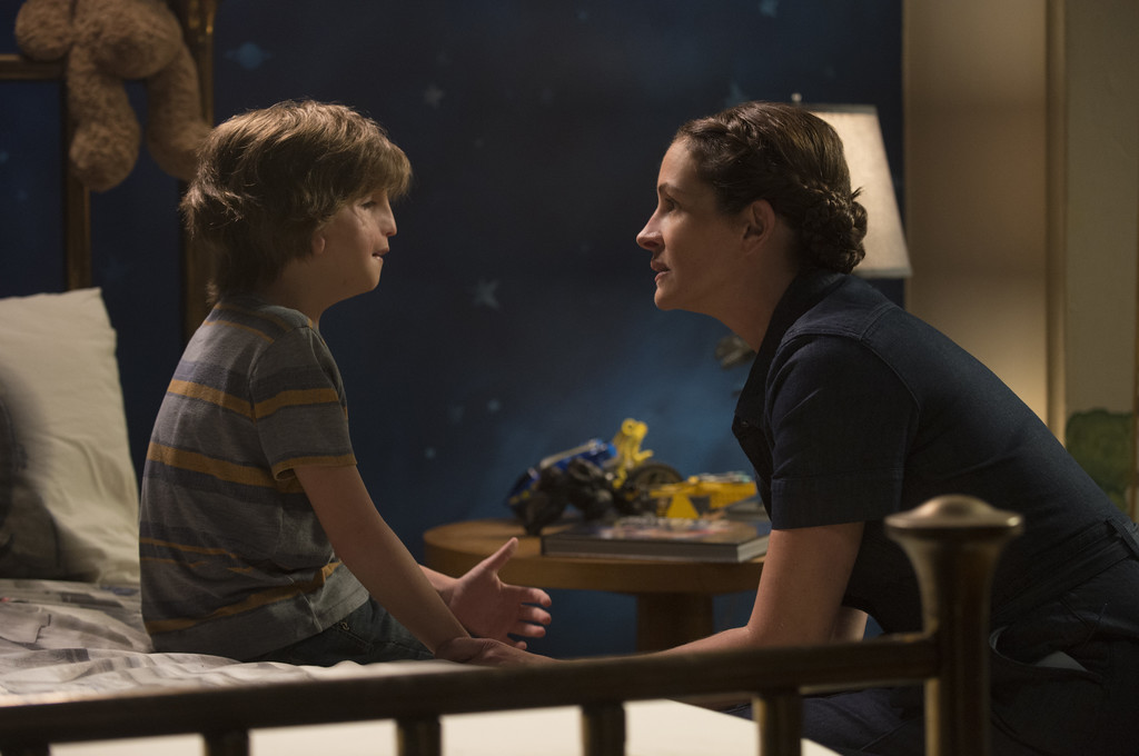 ". Jacob Tremblay and Julia Roberts share a scene in ""Wonder.\"" The movie is in theaters Nov. 17. (Lionsgate Publicity)"