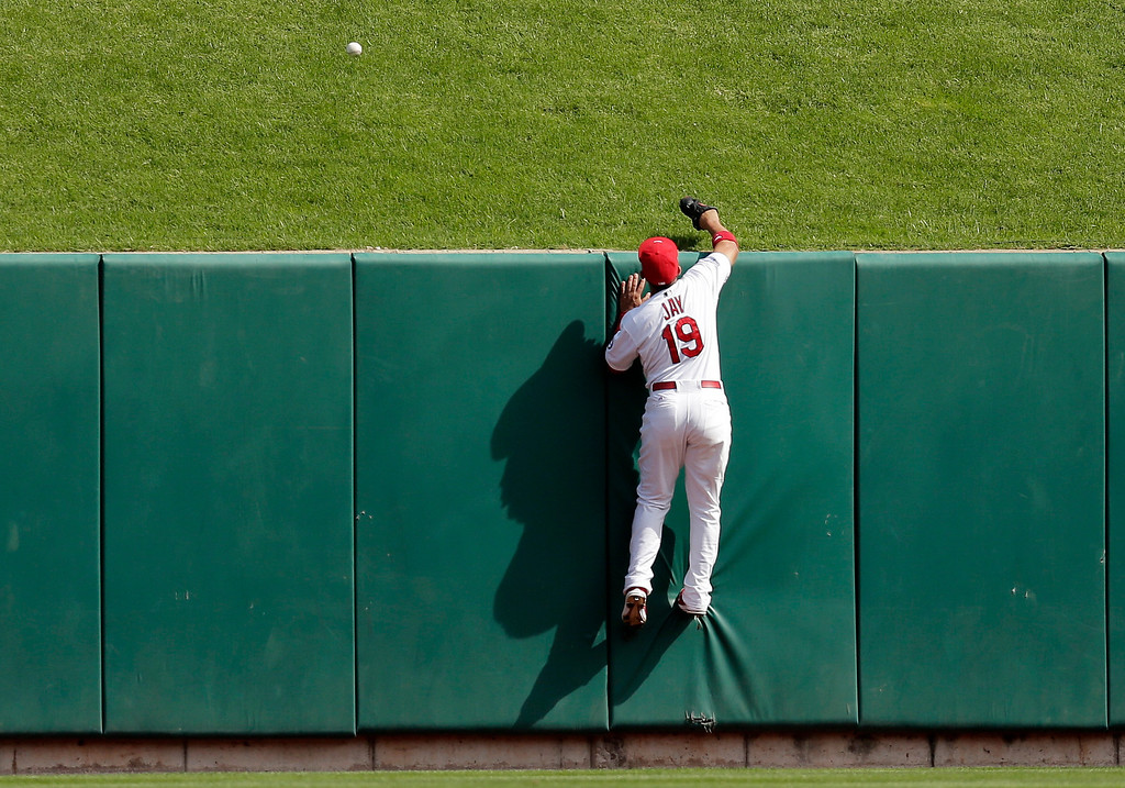 . St. Louis Cardinals center fielder Jon Jay is unable to reach for a two-run home run hit by Pittsburgh Pirates\' Pedro Alvarez in the third inning of Game 2 of baseball\'s National League division series on Friday, Oct. 4, 2013, in St. Louis. (AP Photo/Charlie Riedel)