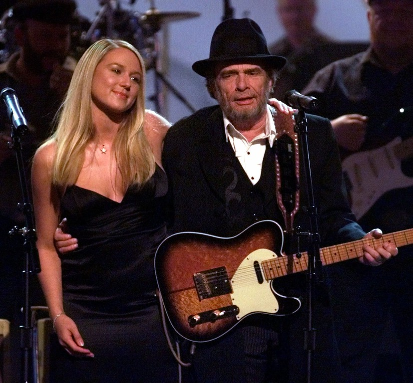 . Pop singer Jewel performs with country music legend Merle Haggard at the Country Music Association Awards show in Nashville, Tenn., Wednesday, Sept. 22, 1999. (AP Photo/Michael S. Green)