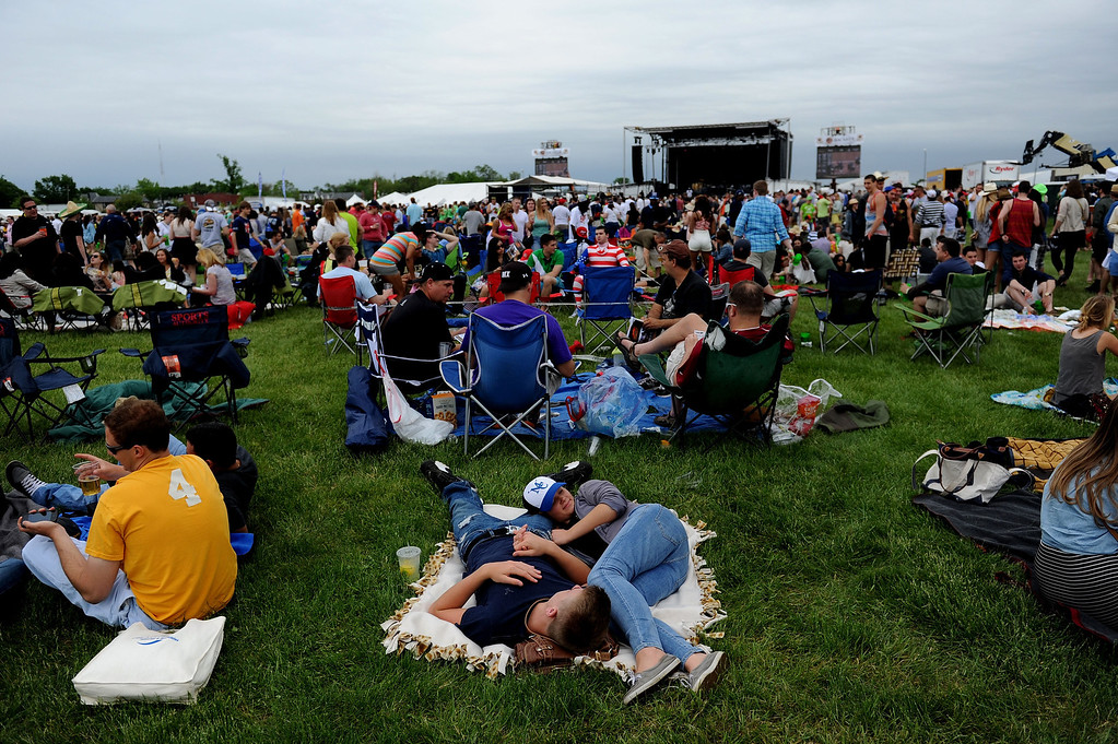 . BALTIMORE, MD - MAY 18:  Fans gather in the in field prior to the 138th running of the Preakness Stakes at Pimlico Race Course on May 18, 2013 in Baltimore, Maryland.  (Photo by Patrick Smith/Getty Images)