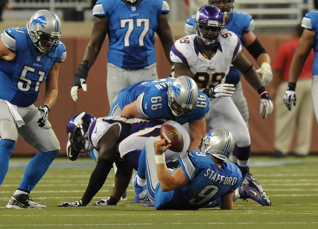 . Detroit Lions quarterback Matthew Stafford scrambled for yardage, and appeared to lose the football to the Minnesota Vikings with about ten seconds left in the fourth quarter.  Replay overturned the fumble ruling and gave Detroit the ball back.  The Vikings beat the Lions 20-13.  Photo taken on Sunday, September 30, 2012, at Ford Field in Detroit, Mich.  (Special to The Oakland Press/Jose Juarez)
