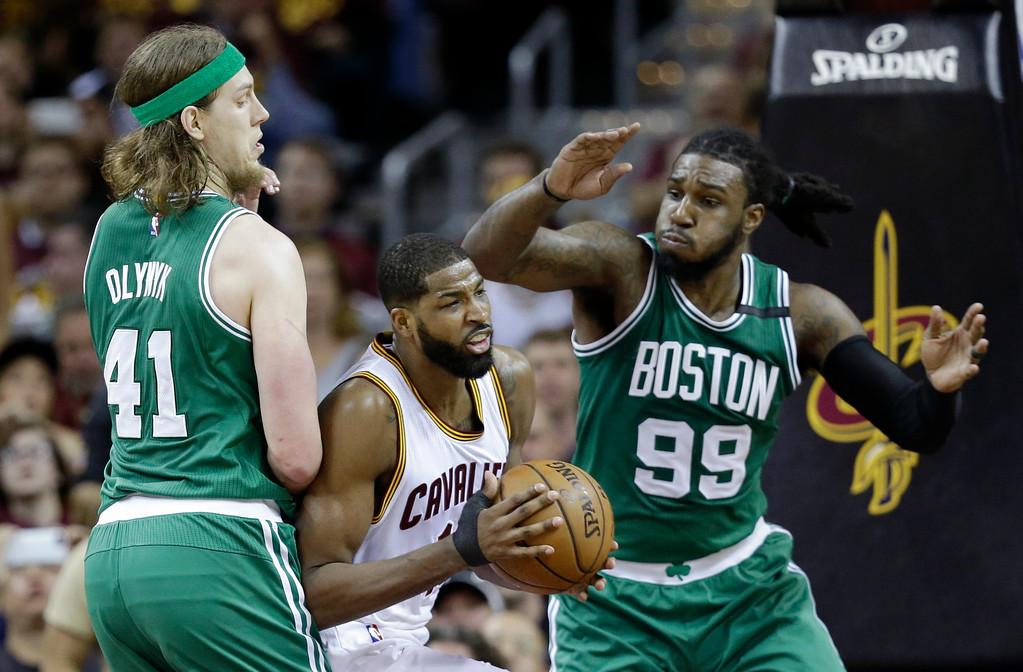 . Cleveland Cavaliers\' Tristan Thompson (13) looks to pass against Boston Celtics\' Kelly Olynyk (41) and Jae Crowder (99) during the first half of Game 4 of the NBA basketball Eastern Conference finals, Tuesday, May 23, 2017, in Cleveland. (AP Photo/Tony Dejak)