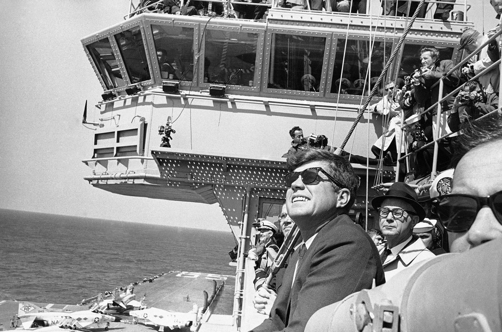 . Kennedy observes a flight of planes from the Carrier Enterprise during a demonstration off the Carolina coast April 14, 1962. Associated Press file