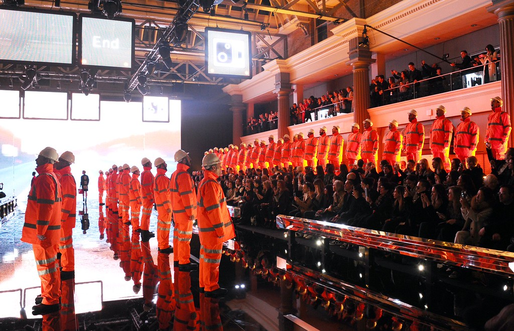 . A male choir dressed as road workers sing on the runway during the Anya Hindmarch show during London Fashion Week Fall/Winter 2015/16 at  on February 24, 2015 in London, England.  (Photo by Stuart C. Wilson/Getty Images)