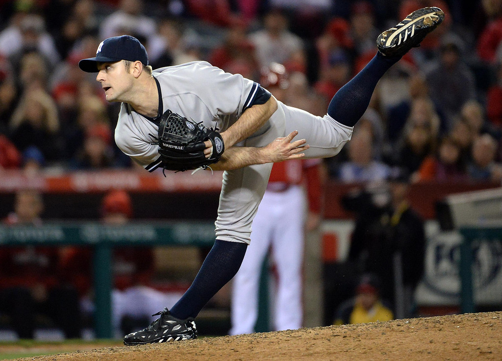. New York Yankees relief pitcher David Robertson throws to the plate against the Los Angeles Angels in the ninth inning of a baseball game at Anaheim Stadium in Anaheim, Calif., on Tuesday, May 6, 2014.  (Keith Birmingham Pasadena Star-News)
