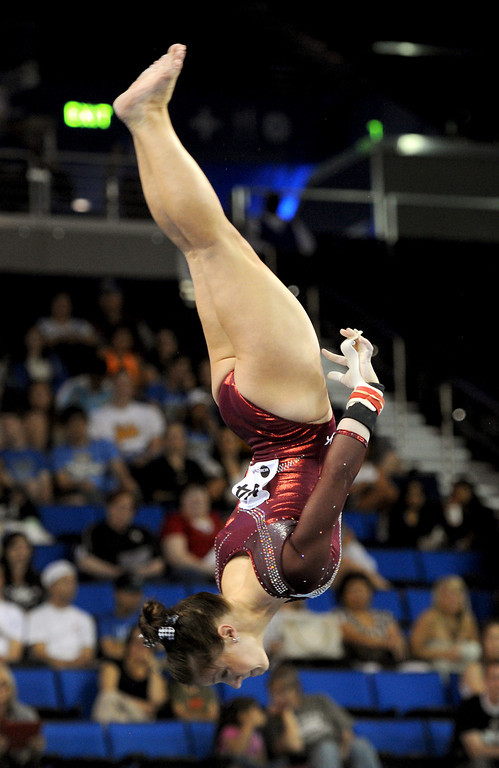 . Alabama\'s Sarah DeMeo competes in the uneven parallel bars Friday, April 19, 2013, at the NCAA Women\'s Gymnastics Championships at Pauley Pavilion. (Michael Owen Baker/Staff Photographer)