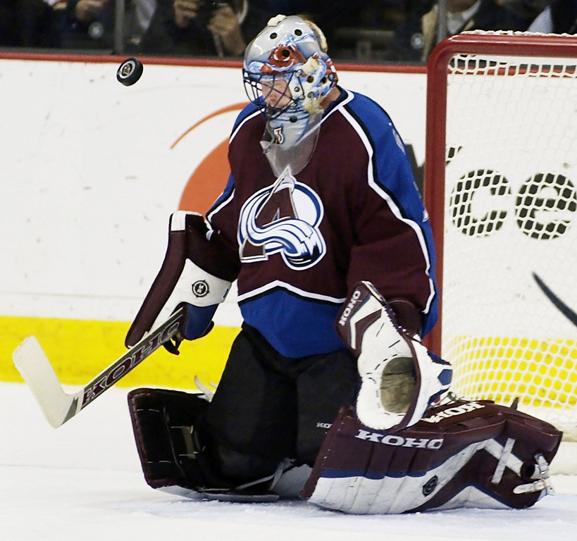 . Colorado Avalanche goalie Patrick Roy stops a Minnesota Wild shot during the first period of Game 3 of their Western Conference quarterfinal series Monday, April 14, 2003, in St. Paul, Minn. (AP Photo/Tom Olmscheid)