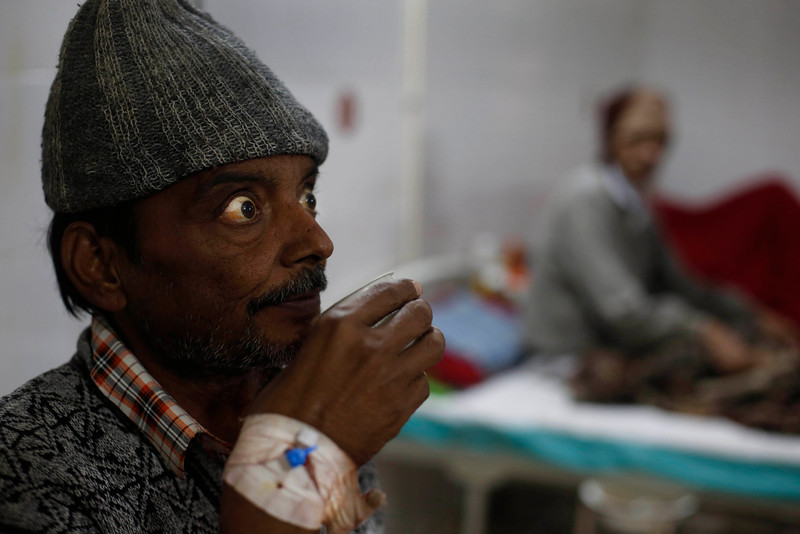 . In this Sunday, Feb. 2, 2014 photo, an unidentified patient suffering from tuberculosis sips tea while sitting on his bed at Lal Bahadur Shastri Government Hospital at Ram Nagar in Varanasi, India. (AP Photo/Rajesh Kumar Singh)