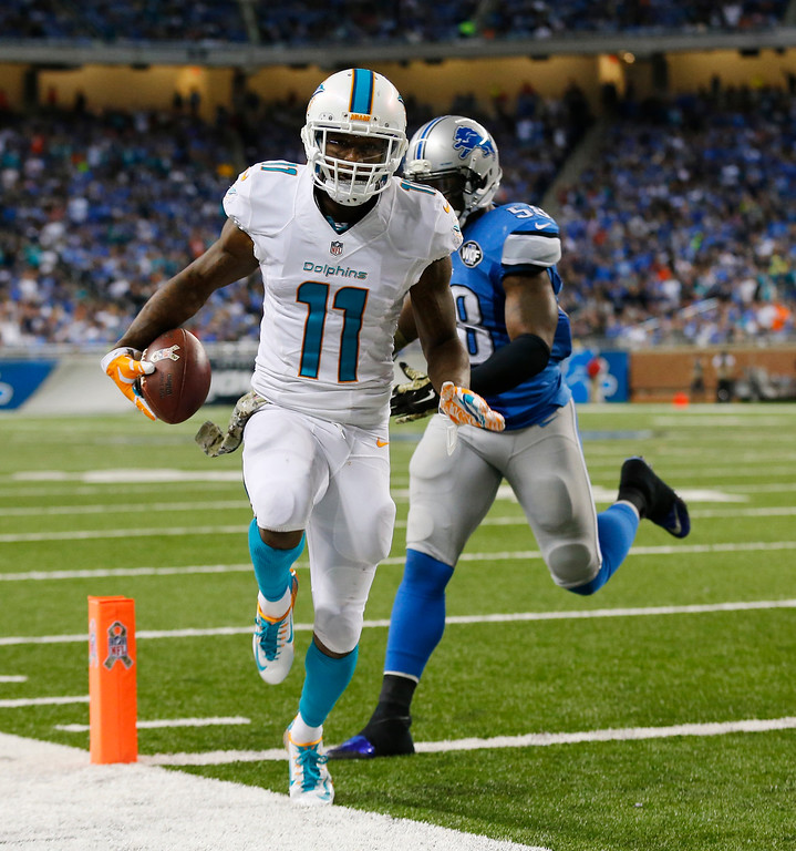 . Miami Dolphins wide receiver Mike Wallace (11) outruns Detroit Lions outside linebacker Ashlee Palmer (58) for a touchdown during the second half of an NFL football game in Detroit, Sunday, Nov. 9, 2014. (AP Photo/Paul Sancya)