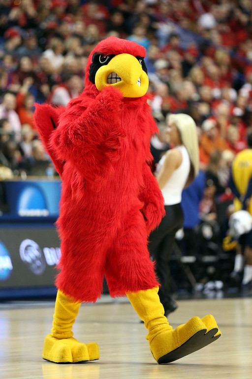 . LEXINGTON, KY - MARCH 21:  The Louisville Cardinals mascot performs during the second round of the 2013 NCAA Men\'s Basketball Tournament at the Rupp Arena on March 21, 2013 in Lexington, Kentucky.  (Photo by Andy Lyons/Getty Images)