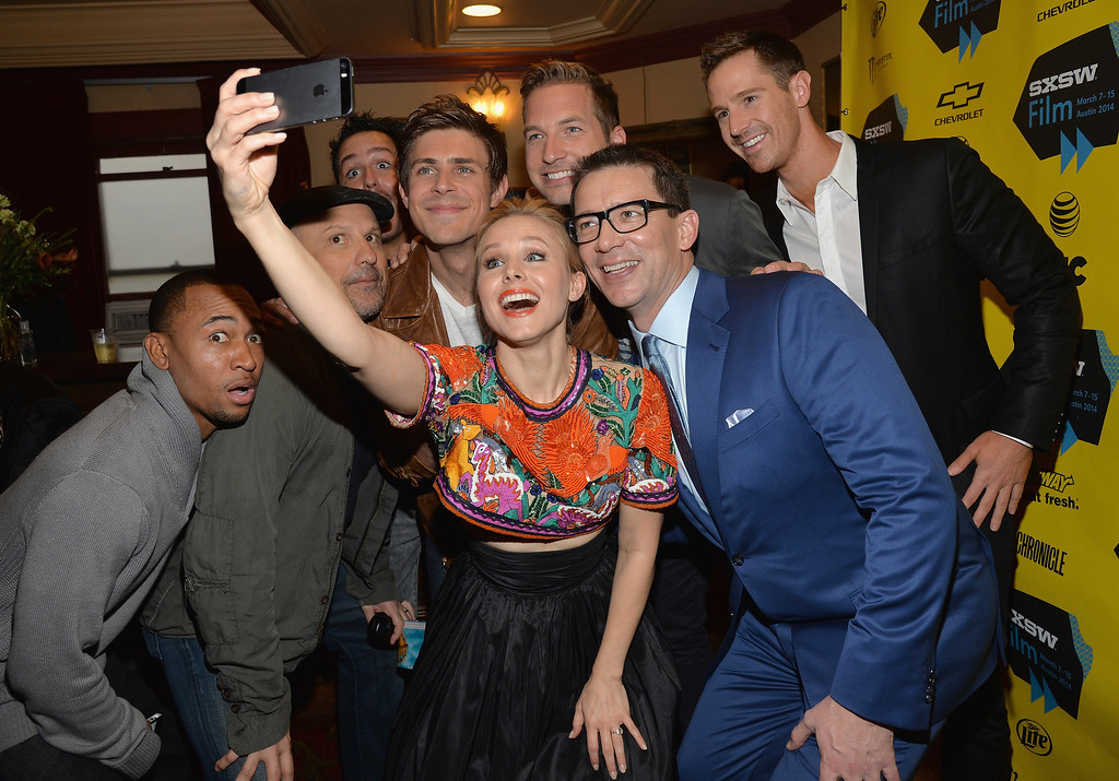""". Actress Kristen Bell (C) poses for a selfie with cast members (L-R) Percy Daggs, Enrico Colantoni, Chris Lowell, Ryan Hansen, Jason Dohring and director Rob Thomas at the premiere of \""""Veronica Mars\"""" during the 2014 SXSW Music, Film + Interactive Festival at the Paramount Theatre on March 8, 2014 in Austin, Texas.  (Photo by Michael Buckner/Getty Images for SXSW)"""