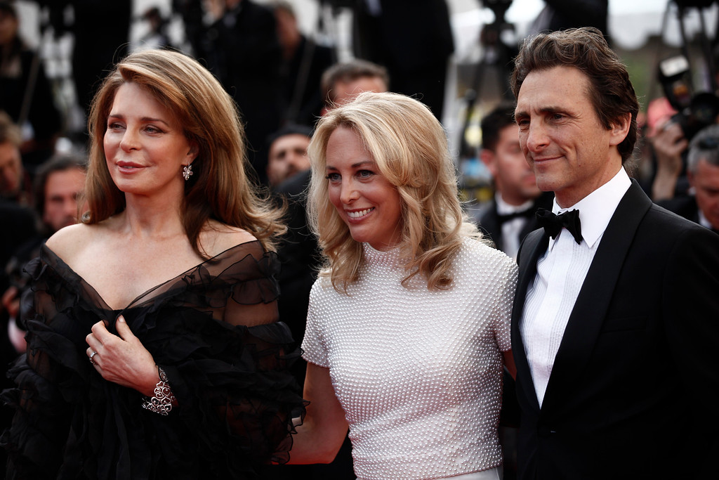 """. From left, Queen Noor of Jordan, Lawrence Bender and Valerie Plame Wilson arrive for the screening of \""""Biutiful\"""", at the 63rd international film festival, in Cannes, southern France, Monday, May 17, 2010. (AP Photo/Matt Sayles)"""