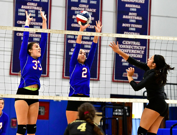 9/27/2018 Mike Orazzi | Staff St. Paul Volleyball's Kelsi Blatchley (33), Greta Panke (2) and Woodland's Fatima Khalid (29) Thursday night in Bristol.