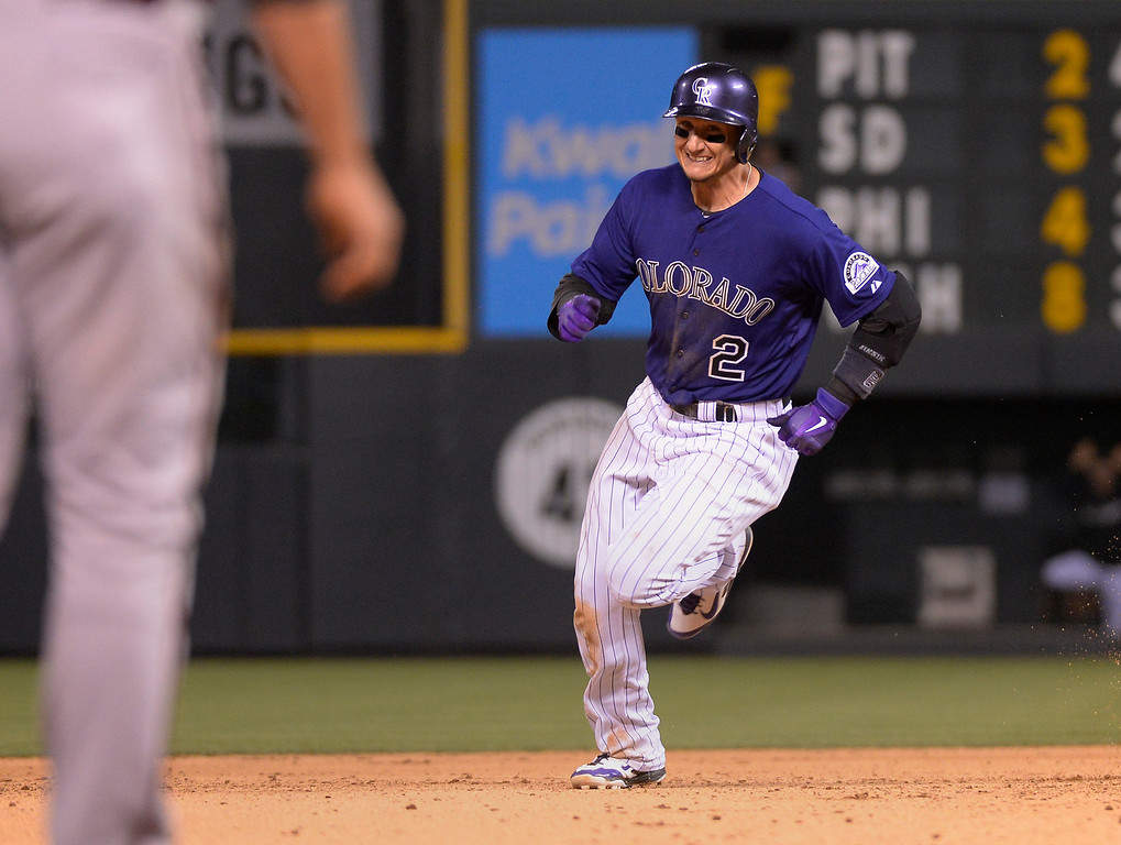 . Colorado Rockies shortstop Troy Tulowitzki (2) rounds second base on a Colorado Rockies right fielder Michael Cuddyer (3) hit int he seventh inning against the Arizona Diamondbacks June 4, 2014 at Coors Field. (Photo by John Leyba/The Denver Post)