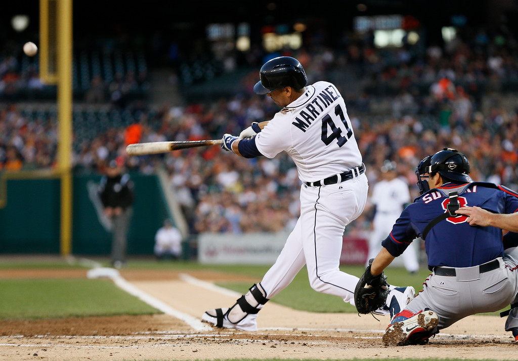 . Detroit Tigers\' Victor Martinez (41) hits a two-run home run off Minnesota Twins pitcher Trevor May in the first inning of a baseball game in Detroit, Thursday, Sept. 25, 2014. (AP Photo/Paul Sancya)