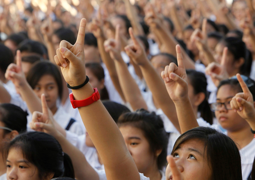 Description of . Thousands of students and faculty members dance to the theme song of the One Billion Rising campaign in the quadrangle of the St. Scholastica college in Manila February 14, 2013. One Billion Rising is a global campaign to call for an end to violence against women and girls, according to its organisers.  REUTERS/Romeo Ranoco