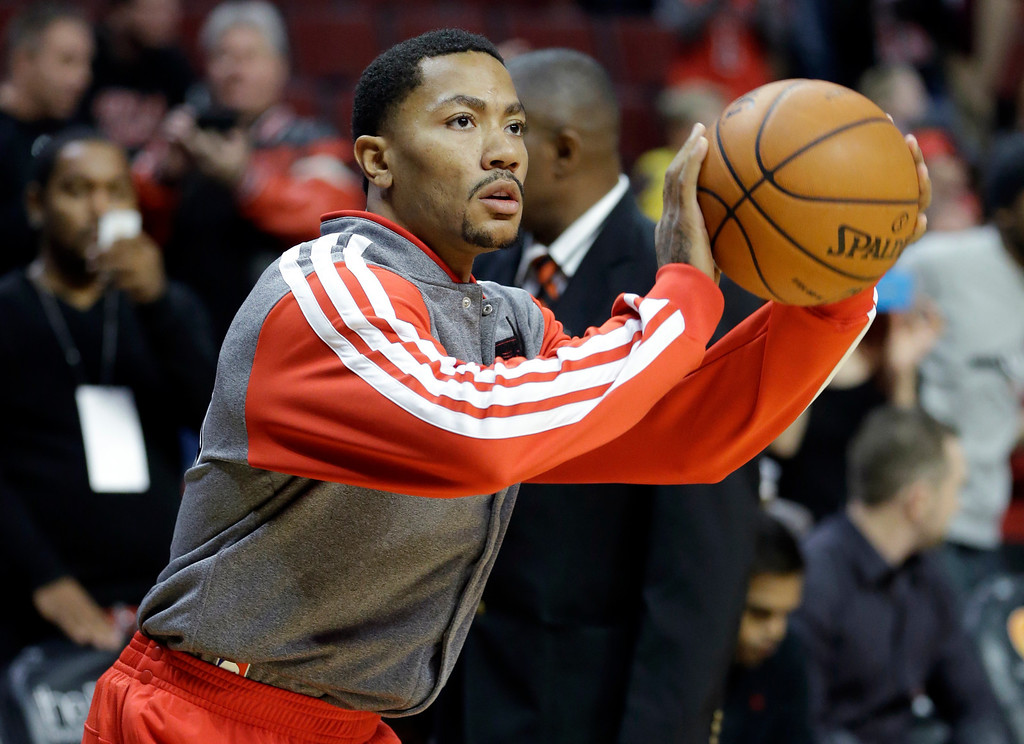 . Chicago Bulls guard Derrick Rose warms up before an NBA preseason basketball game against the Denver Nuggets in Chicago on Friday, Oct. 25, 2013. (AP Photo/Nam Y. Huh)
