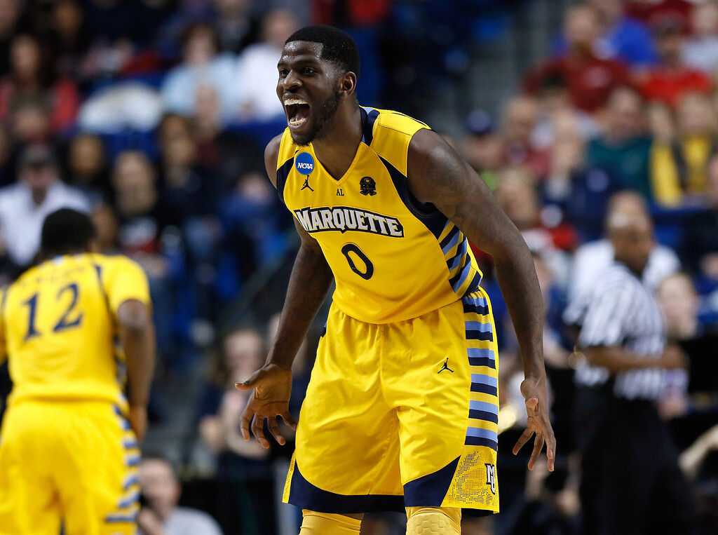 . LEXINGTON, KY - MARCH 23: Jamil Wilson #0 of the Marquette Golden Eagles reacts after a play in the second half against the Butler Bulldogs during the third round of the 2013 NCAA Men\'s Basketball Tournament at Rupp Arena on March 23, 2013 in Lexington, Kentucky.  (Photo by Kevin C. Cox/Getty Images)