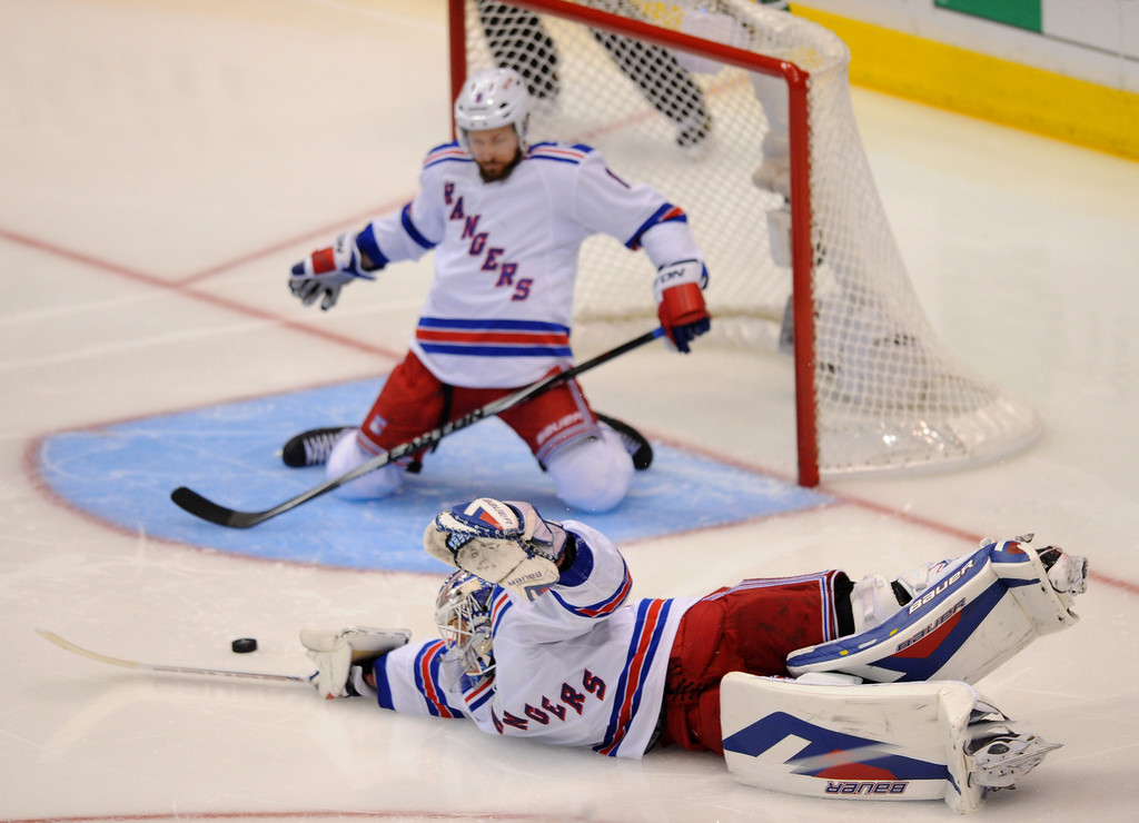 . Rangers goalie Henrik Lundqvist misses a goal by the Kings\' Jarret Stoll in the second-period of game two of the Stanley Cup Final, Saturday, June 7, 2014, at Staples Center. (Photo by Michael Owen Baker/Los Angeles Daily News)