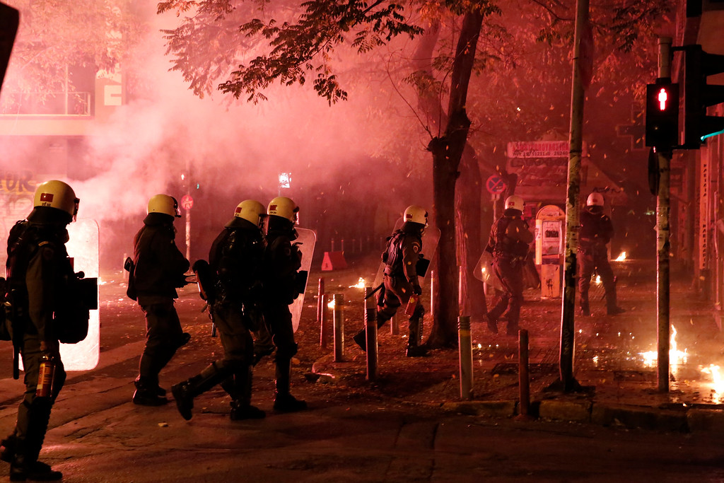 . Riot police operate as protesters throw petrol bombs and flares against them during clashes in the Athens neighborhood of Exarchia, a haven for extreme leftists and anarchists, on Saturday, Dec. 6, 2014. (AP Photo/Petros Giannakouris)